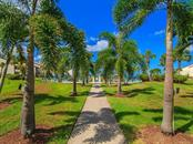 Walkway to swimming pool - Condo for sale at 6236 Midnight Pass Rd #406, Sarasota, FL 34242 - MLS Number is A4188093