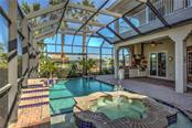 Relax in your pool with flowing spa and waterfall effects. Color changing pool lights. Pool has both gas and solar heat ability. - Single Family Home for sale at 548 Fore Dr, Bradenton, FL 34208 - MLS Number is A4196590