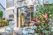 Relax on the outside patio and soak in the sunshine. - Condo for sale at 1618 Starling Dr #105, Sarasota, FL 34231 - MLS Number is A4204864