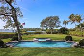 Swimming pool, spa and backyard with bay views - Single Family Home for sale at 3930 Red Rock Way, Sarasota, FL 34231 - MLS Number is A4207508