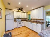 Kitchen - Single Family Home for sale at 411 Lyons Bay Rd, Nokomis, FL 34275 - MLS Number is A4209146