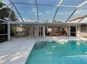 Pool to lanai and interior - Single Family Home for sale at 445 Mahon Dr, Venice, FL 34285 - MLS Number is A4209507