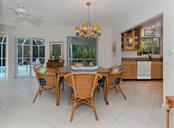 Dining room/kitchen - Single Family Home for sale at 445 Mahon Dr, Venice, FL 34285 - MLS Number is A4209507