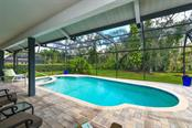 Screened Pool and large lanai and naturally wooded area behind home where you wwill see deer almost every day. Note brick pavers. - Single Family Home for sale at 7536 Weeping Willow Dr, Sarasota, FL 34241 - MLS Number is A4210209
