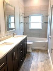 spare bath with dual sinks - Single Family Home for sale at 6010 Hollywood Blvd, Sarasota, FL 34231 - MLS Number is A4400462