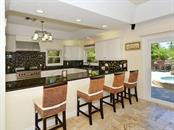 Kitchen - Breakfast Bar - Single Family Home for sale at 85 S Polk Dr, Sarasota, FL 34236 - MLS Number is A4400870