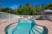 Pool & pavered surround with chaise lounges - Single Family Home for sale at 6661 Gulf Of Mexico Dr, Longboat Key, FL 34228 - MLS Number is A4410988