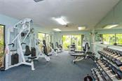Well-equipped fitness center - workout with this view! - Condo for sale at 1716 Starling Dr #204, Sarasota, FL 34231 - MLS Number is A4412237