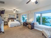 En-suite bedroom with bay views - Single Family Home for sale at 425 Meadow Lark Dr, Sarasota, FL 34236 - MLS Number is A4415655