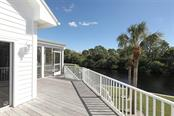 Rear Deck and Stairs - Single Family Home for sale at 13114 Via Flavia, Placida, FL 33946 - MLS Number is A4416122