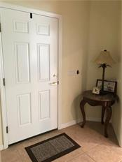 Front door and foyer. - Villa for sale at 252 Fairway Isles Ln, Bradenton, FL 34212 - MLS Number is A4417217