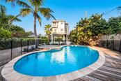 Pool view - Single Family Home for sale at 7130 Longboat Dr E, Longboat Key, FL 34228 - MLS Number is A4418105