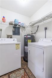 Large Walk in Laundry Closet with storage. - Villa for sale at 5235 Myrtle Wood #18, Sarasota, FL 34235 - MLS Number is A4418558