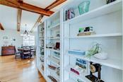 The custom built-in shelves gives you endless display possibilities for cherished treasures and beach finds - Single Family Home for sale at 521 75th St, Holmes Beach, FL 34217 - MLS Number is A4420243