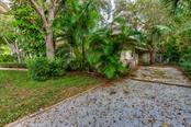 Loads of additional parking along with a second patio and entry on the south side of the home, lots of extra room for parking multiple vehicles. - Single Family Home for sale at 1509 Flower Dr, Sarasota, FL 34239 - MLS Number is A4421898