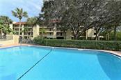 Clubhouse with fitness center and saunas overlook the heated and lit north pool. Perfect for laps and water aerobics. - Condo for sale at 4700 Gulf Of Mexico Dr #305, Longboat Key, FL 34228 - MLS Number is A4422164