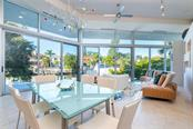 Floor to ceiling hurricane-grade sliding doors and windows bring the outside, in and offers ample energizing natural light throughout the home. - Single Family Home for sale at 509 Venice Ln, Sarasota, FL 34242 - MLS Number is A4425092