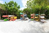 Beachside canoe/kayak storage racks for exclusive use by Whispering Sands owners. - Condo for sale at 225 Hourglass Way #208, Sarasota, FL 34242 - MLS Number is A4425323