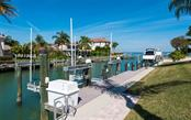Single Family Home for sale at 561 Ketch Ln, Longboat Key, FL 34228 - MLS Number is A4426280