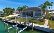 New 108 ft Vinyl Seawall, cap and tie-rods.  76 feet of Trex dock and a 40,000 LB lift. - Single Family Home for sale at 561 Ketch Ln, Longboat Key, FL 34228 - MLS Number is A4426280