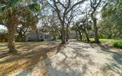 Rear of the property - Single Family Home for sale at 2215 Shadow Wood Ln, Sarasota, FL 34240 - MLS Number is A4427846