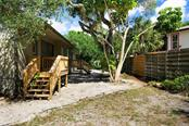 Backyard privacy. - Single Family Home for sale at 1302 Roberts Bay Ln, Sarasota, FL 34242 - MLS Number is A4433097