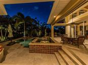 Peaceful Pool / Spa Patio area right after sunset. - Single Family Home for sale at 1361 Bayshore Dr, Englewood, FL 34223 - MLS Number is A4433943