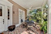 A second, lovely seating area on the opposite end of the open porch, perfect for entertaining or relaxing with a cup of coffee on a Saturday morning. - Single Family Home for sale at 813 Hudson Ave, Sarasota, FL 34236 - MLS Number is A4437601