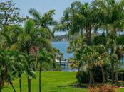Peek-a-boo views of the bay from the house - Single Family Home for sale at 158 Puesta Del Sol, Osprey, FL 34229 - MLS Number is A4439362