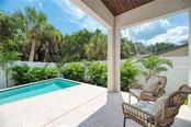 Covered Porch/Pool Deck - Single Family Home for sale at 5035 Sandy Beach Ave, Sarasota, FL 34242 - MLS Number is A4445640