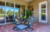 Relaxing lanai space for dining. - Single Family Home for sale at 8727 53rd Ter E, Bradenton, FL 34211 - MLS Number is A4447005