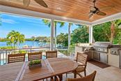 Covered outdoor dining space with summer kitchen. - Single Family Home for sale at 711 Mangrove Point Rd, Sarasota, FL 34242 - MLS Number is A4447637