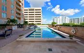 Relax with neighbors and friends around the pool - Condo for sale at 1350 Main St #804, Sarasota, FL 34236 - MLS Number is A4451085