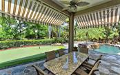 Dine al fresco in the privacy of your backyard. - Single Family Home for sale at 586 N Macewen Dr, Osprey, FL 34229 - MLS Number is A4451482