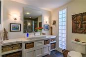 Gulf Suite Bathroom - Single Family Home for sale at 7340 Point Of Rocks Rd, Sarasota, FL 34242 - MLS Number is A4461841
