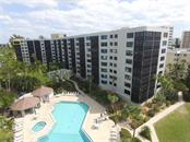 Majestic Casarina and its beautiful pool.  Residence #911 is highlighted on the top floor, leftmost lanai - Condo for sale at 5880 Midnight Pass Rd #911, Sarasota, FL 34242 - MLS Number is A4462559