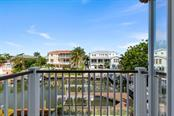 Private balcony from second master bedroom overlooking the canal - Single Family Home for sale at 605 N Point Dr, Holmes Beach, FL 34217 - MLS Number is A4469001