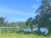 View of River to the SouthEast, trees and foliage can be trimmed back to offer maximum view of the River. - Vacant Land for sale at 1730 Rio Vista Ter, Parrish, FL 34219 - MLS Number is A4470590