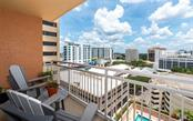 This is the terrace off the great room overlooking the pool deck and the city - Condo for sale at 1350 Main St #1001, Sarasota, FL 34236 - MLS Number is A4472708