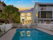 Gorgeous lighting and community pool at sunset - Single Family Home for sale at 500 Beach Rd #1, Sarasota, FL 34242 - MLS Number is A4474527