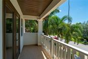 Relaxing upstairs balcony with new decorative railing - Single Family Home for sale at 1907 Clematis St, Sarasota, FL 34239 - MLS Number is A4474600