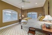 Upstairs Bedroom II overlooks the driveway and features plantation shutters. - Single Family Home for sale at 1807 Oleander St, Sarasota, FL 34239 - MLS Number is A4475067