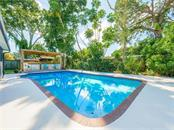 Beautifully landscaped back yard with large pool and cabana. - Single Family Home for sale at 2408 Riverside Dr E, Bradenton, FL 34208 - MLS Number is A4480609