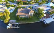 10,000 lb boatlift, floating dock, jet ski lift and platform deck - Single Family Home for sale at 9219 Bimini Dr, Bradenton, FL 34210 - MLS Number is A4483083
