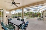 Huge covered lanai with outdoor kitchen - all freshly painted - Single Family Home for sale at 7832 Panther Ridge Trl, Bradenton, FL 34202 - MLS Number is A4483837