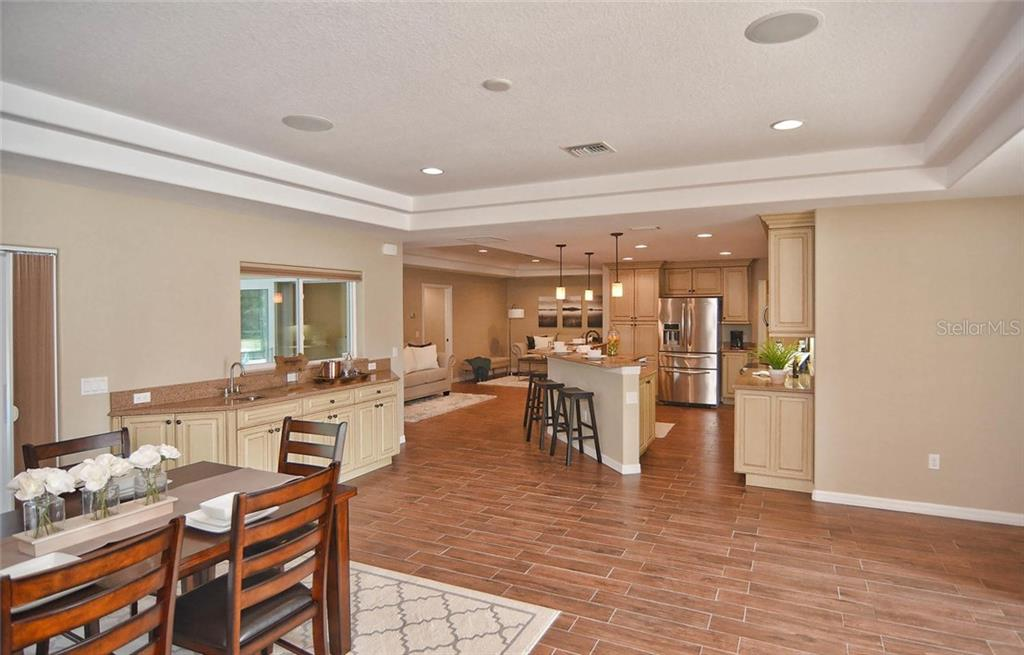 Dining Room/Kitchen/Living Room - Single Family Home for sale at 2505 Northway Dr, Venice, FL 34292 - MLS Number is N5911099