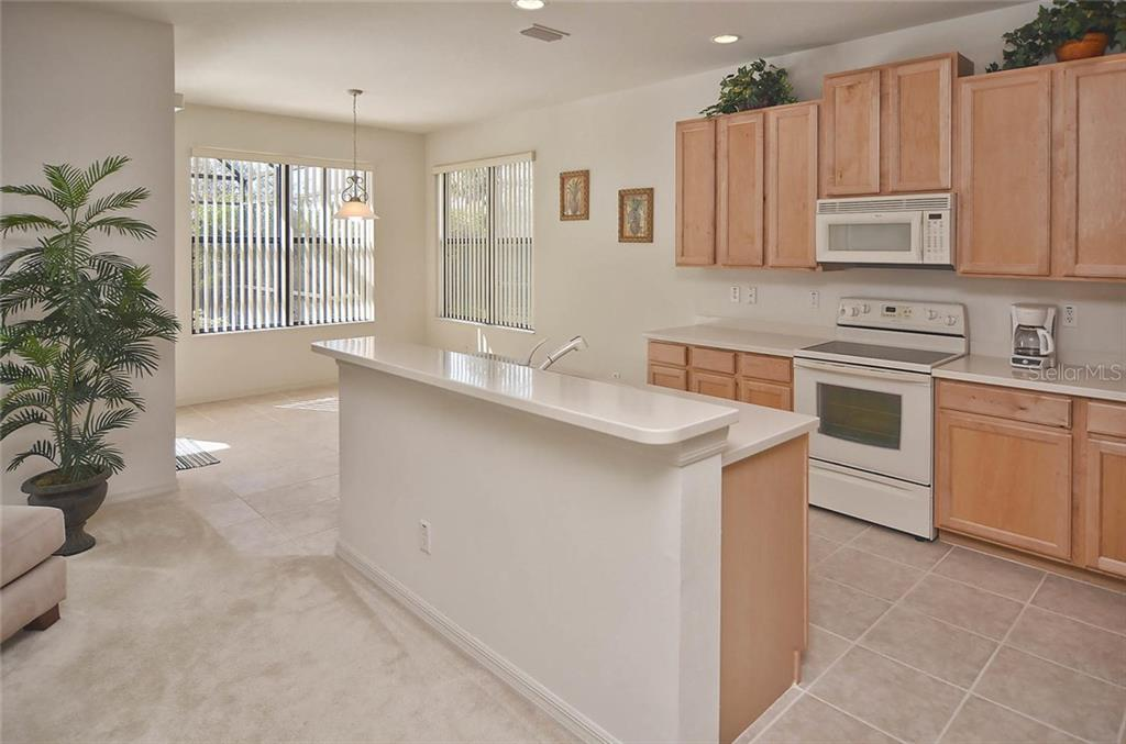 Kitchen to breakfast nook. - Single Family Home for sale at 1975 Batello Dr, Venice, FL 34292 - MLS Number is N5911919