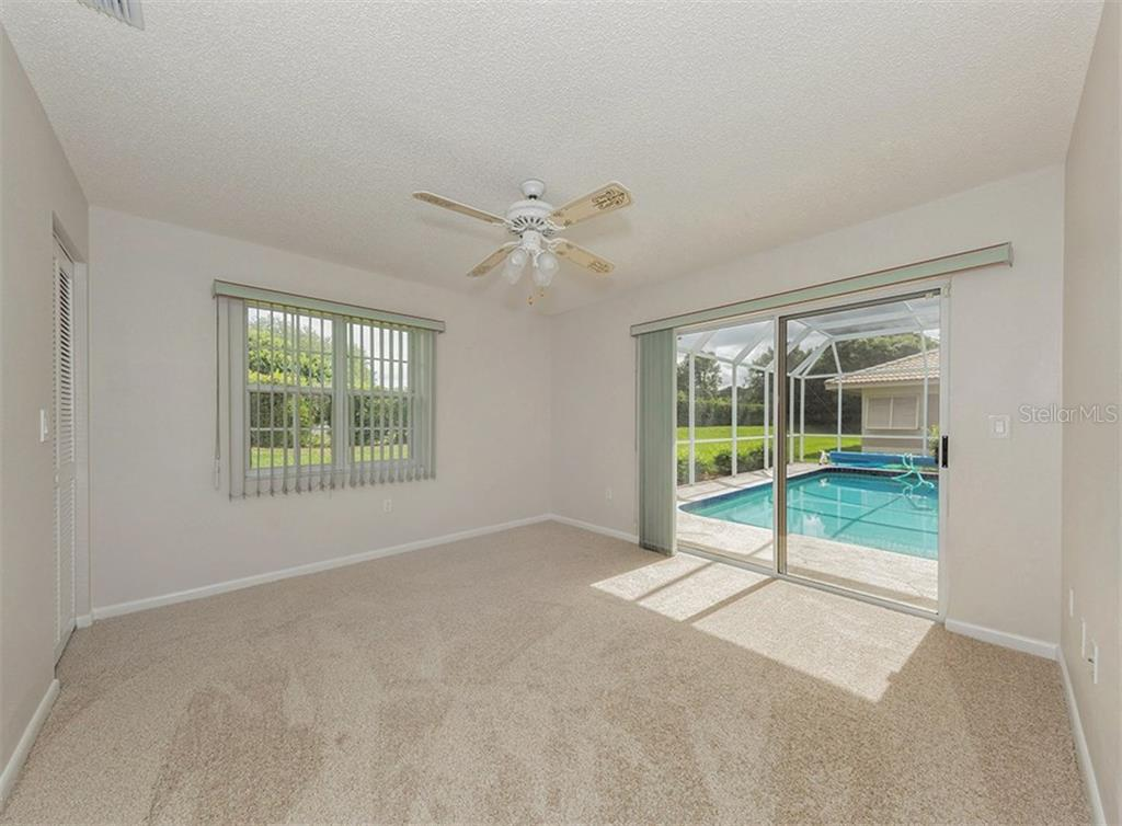 Guest Bedroom - Single Family Home for sale at 3160 Willow Springs Cir, Venice, FL 34293 - MLS Number is N5912811