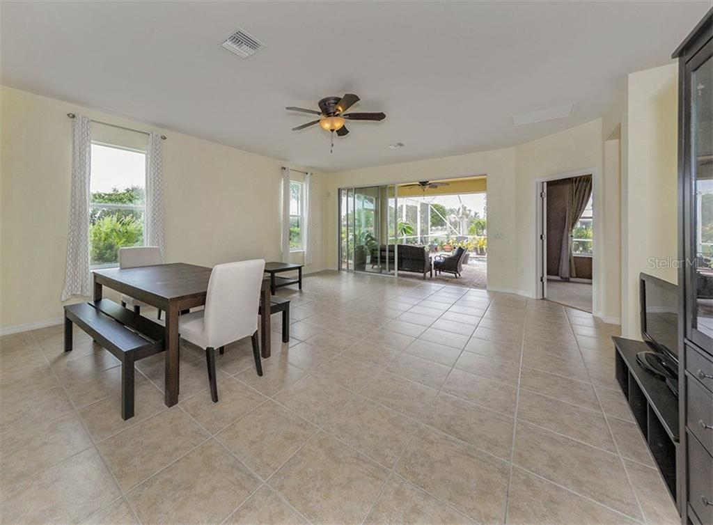 Great room to lanai. - Single Family Home for sale at 19131 Kirella St, Venice, FL 34293 - MLS Number is N5913074