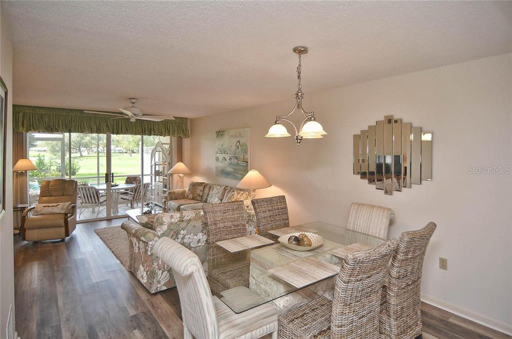 Dining/living room - Condo for sale at 811 Wexford Blvd #811, Venice, FL 34293 - MLS Number is N5914092